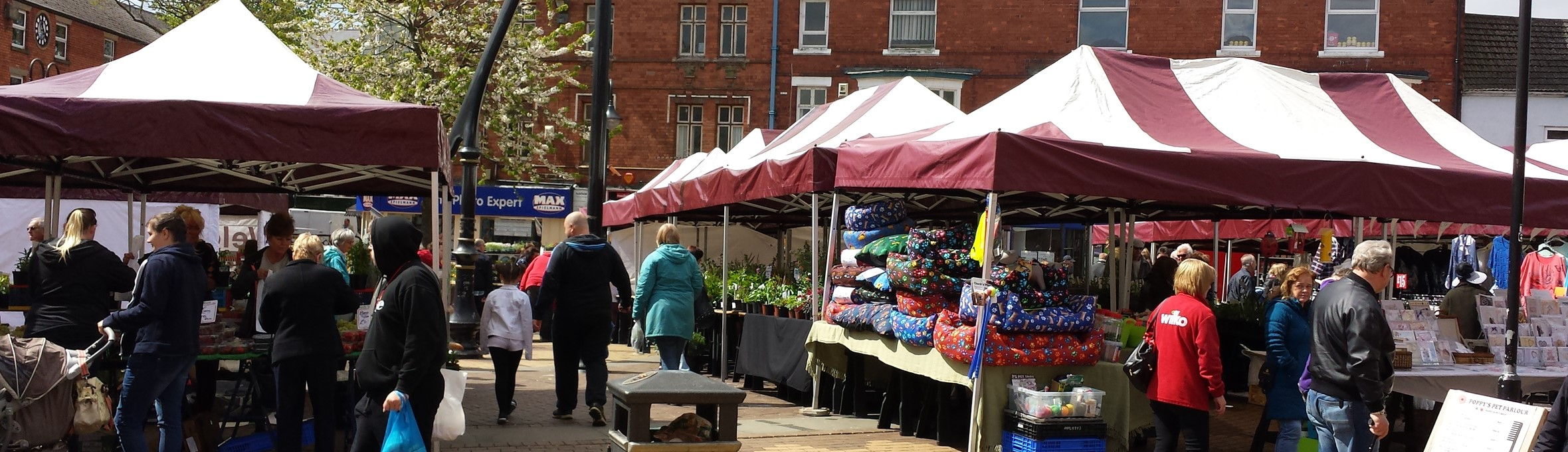Sutton Market place with stalls set out and people shopping