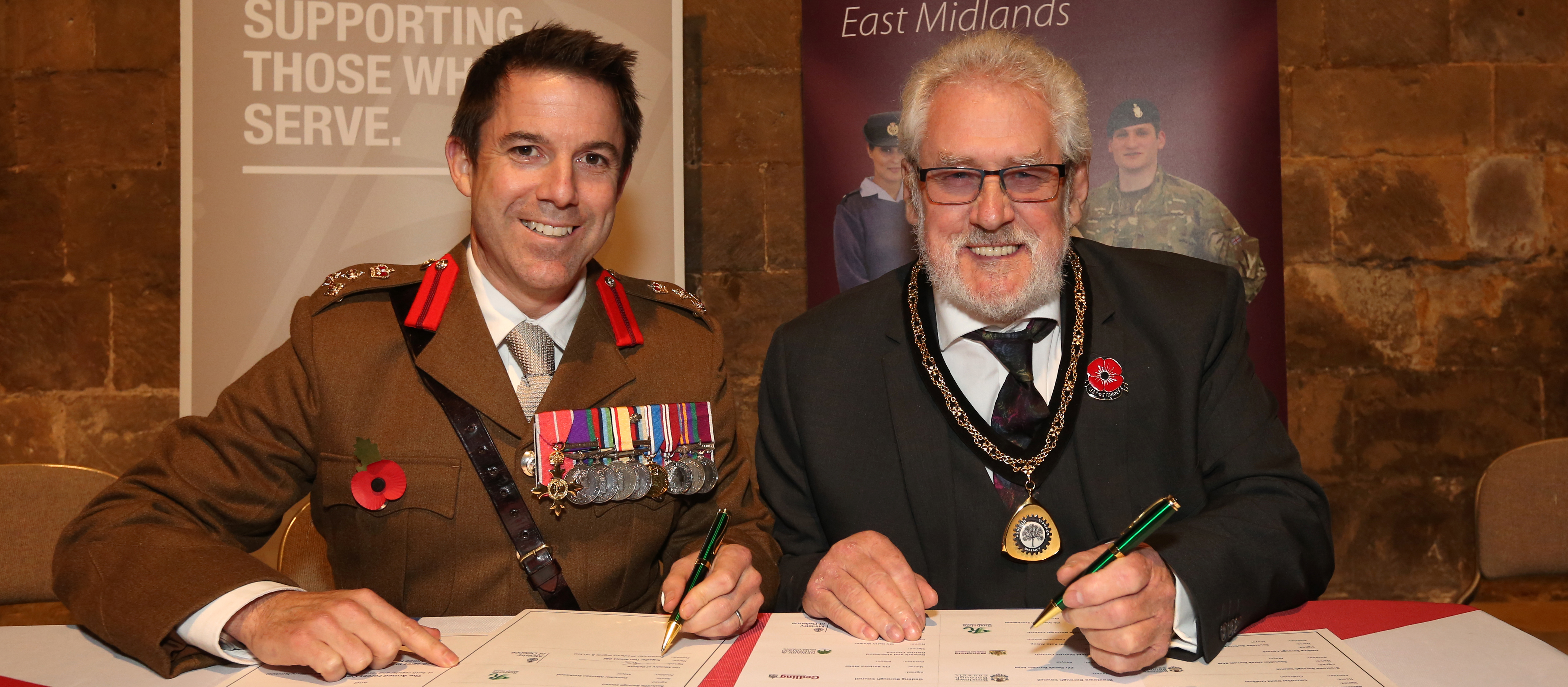 Brigadier Tom Bewick OBE and Vice-Chairman Cllr Anthony Brewer signing the Armed Forces Covenant