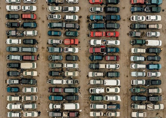 Aerial view of lines of cars in a car park or junk yard
